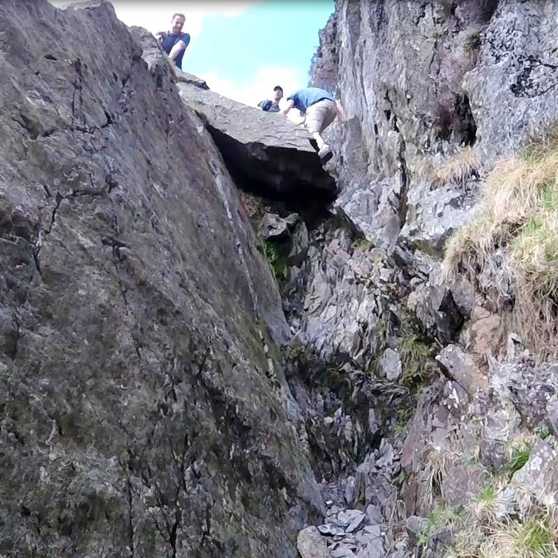 Climbing crux pitch in mid section of Jacks Rake