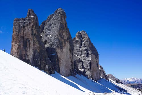 A hiker in front of Drei Zinnen / Tre Cime di Lavaredo