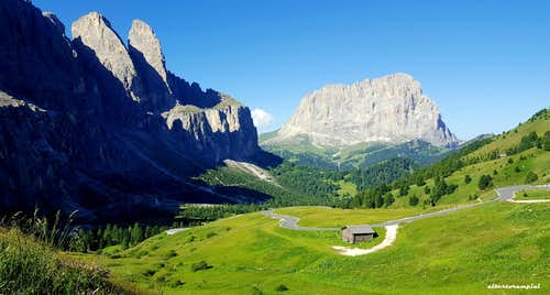 Road to Passo Gardena with Murfreid walls  and Sassolungo