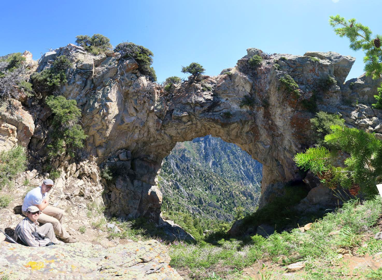 The Devil\'s Eye Arch and Dharma Peak (aka Willow Canyon Peak)