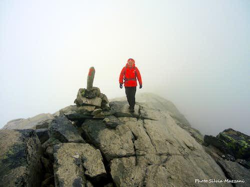 Fog surrounding the summit of Stortoppen, Snøhetta