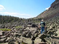 Boulder-hop south below the summit ridge