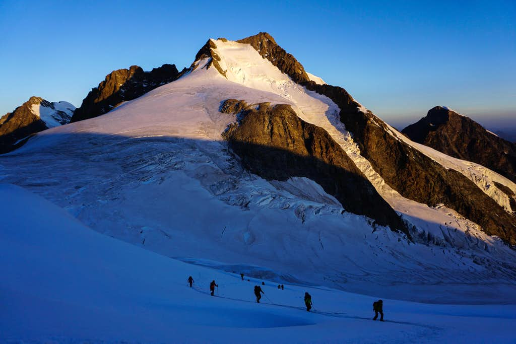 Climbers in front of Piz Bernina (13284 ft / 4049m)