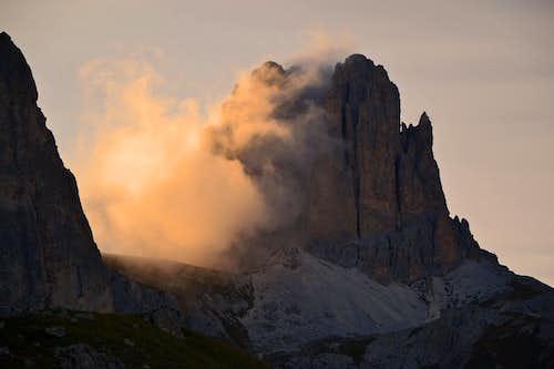 Sunlit evening cloud veiling the Sforcella / Tscheiner Spitze