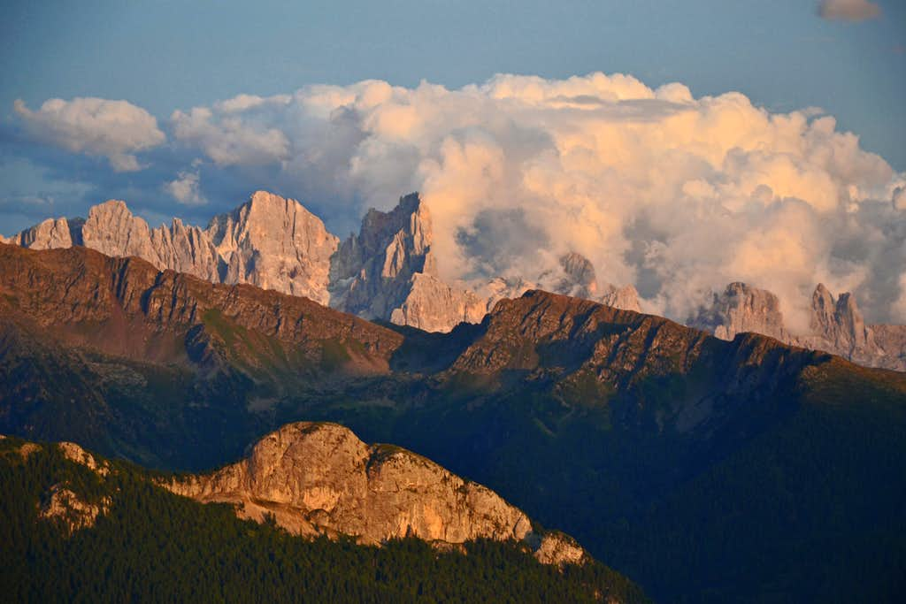 View to the Pale di San Martino group in evening light and cloud