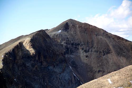 Climber on the summit of