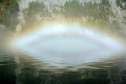 A rainbow on top of the water
