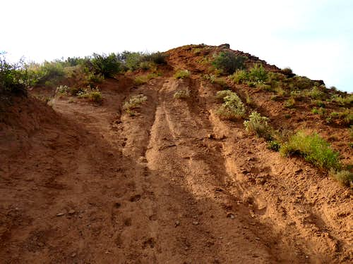 Hiking up the steep red slope