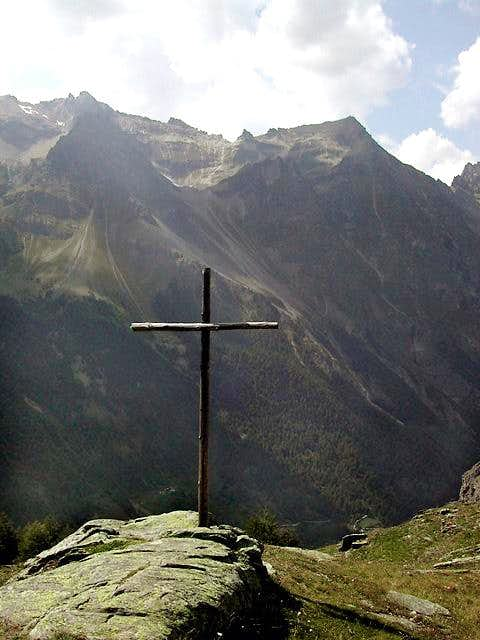 From the cross placed near...