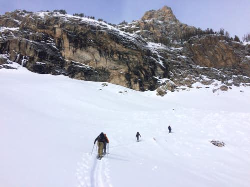 Skiing beneath the cliff at the base of Disappointment Peak