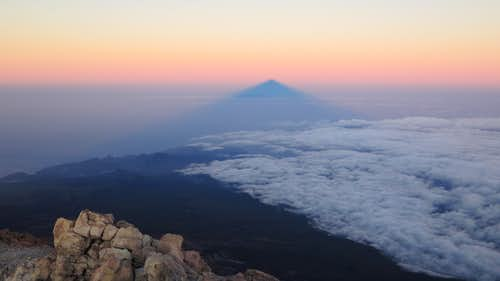 Teide shadow and island of La Palma at sunrise in december