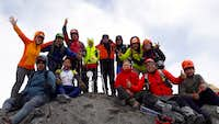 Banos Trail Running with their cross on Tungurahua summit