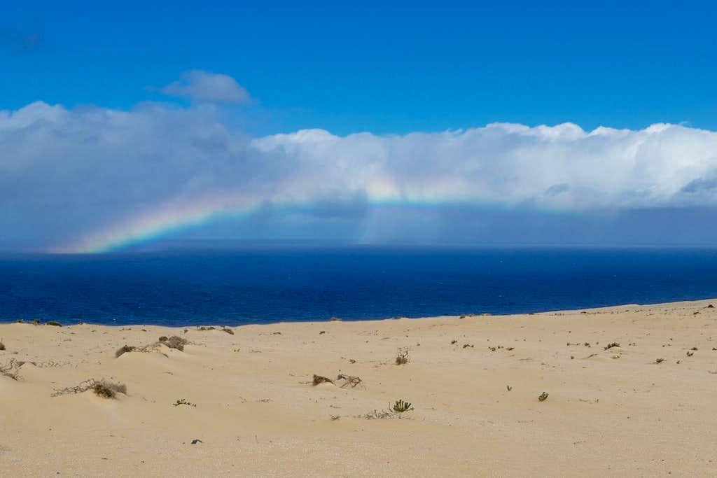 Sand, sea and a rainbow