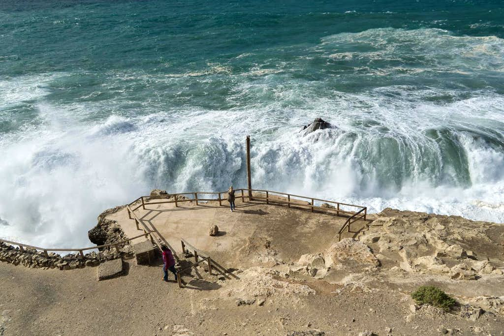 Huge waves break in front of the Cuevas Negras