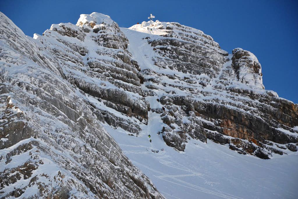 Climbers at the base of the gully leading to the summit of Hoher Dachstein
