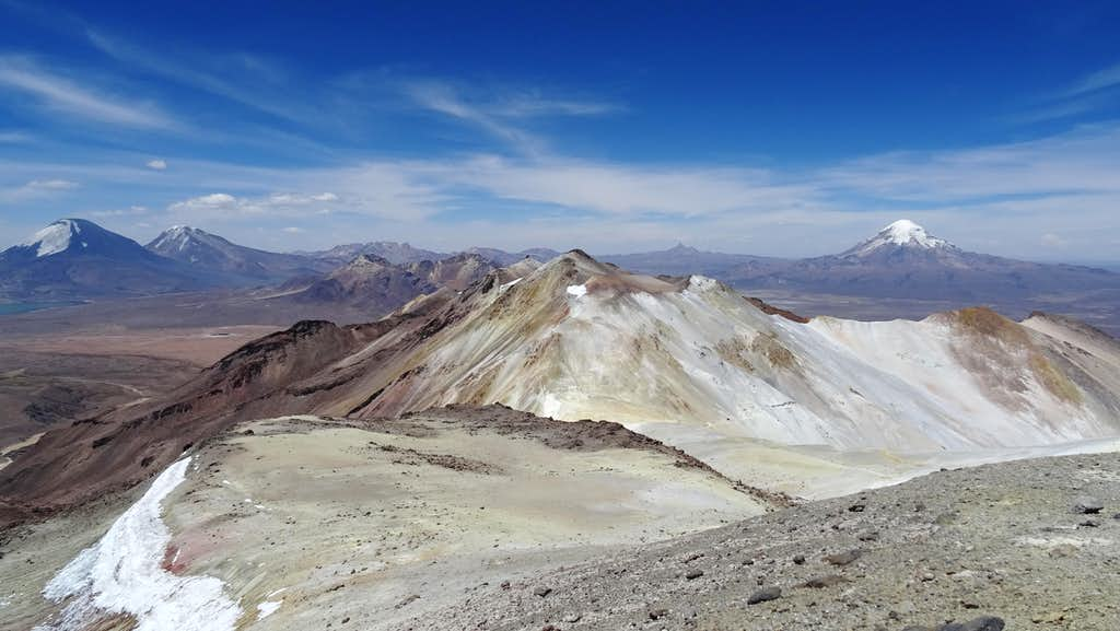 Approaching Acotango summit looking back at Parinacota, Pomerape, Umurata (centre) & Sajama