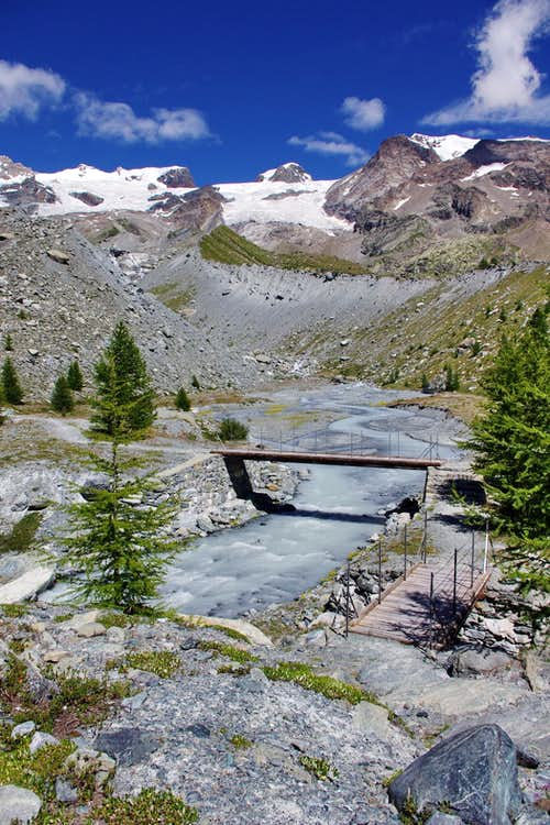 Small bridges crossing the creek that descends from the glaciers of Val d'Ayas