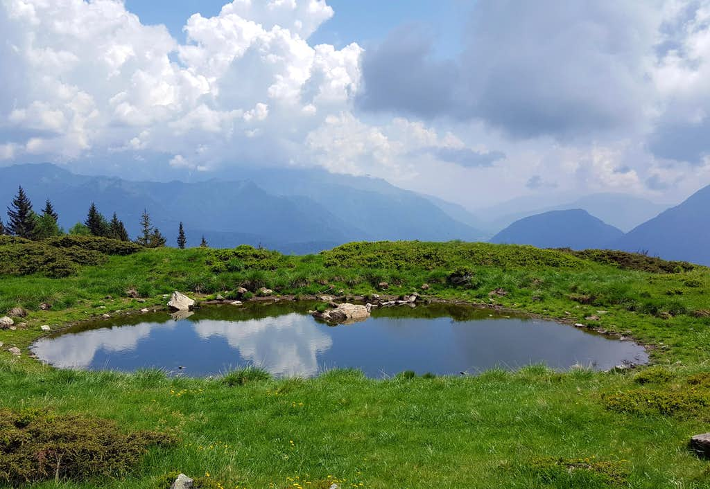 Small alpine pond on the route to Monte Cengledino