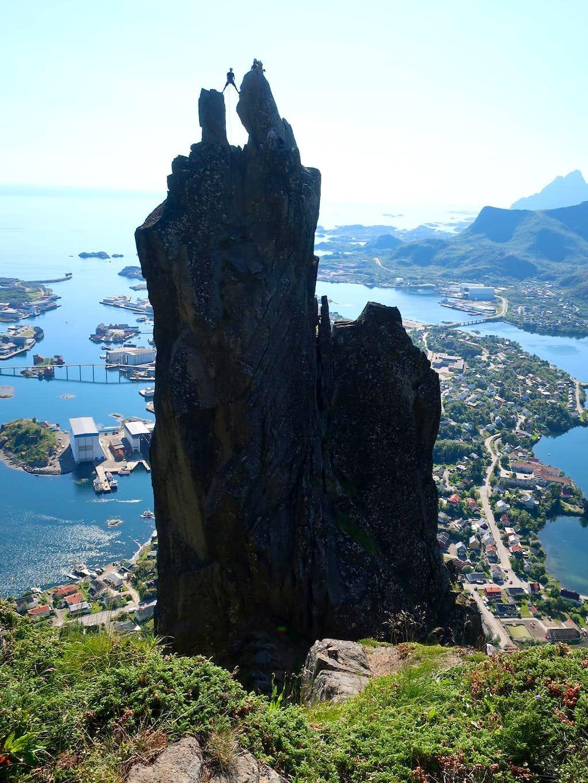 A climber on the spectacular summit of Svolvaergeita