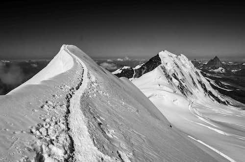 Parrotspitze (14540 ft / 4432 m) summit ridge with Lyskamm (14852 ft / 4527 m) and Matterhorn
