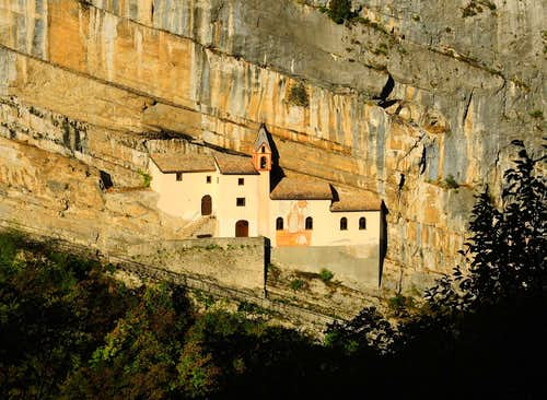 The ancient San Colombano Hermitage suspended on the rocky wall (Vallarsa, Little Dolomites)