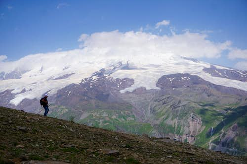 A hiker and Mount elbrus (5642m) as seen from Cheget Peak