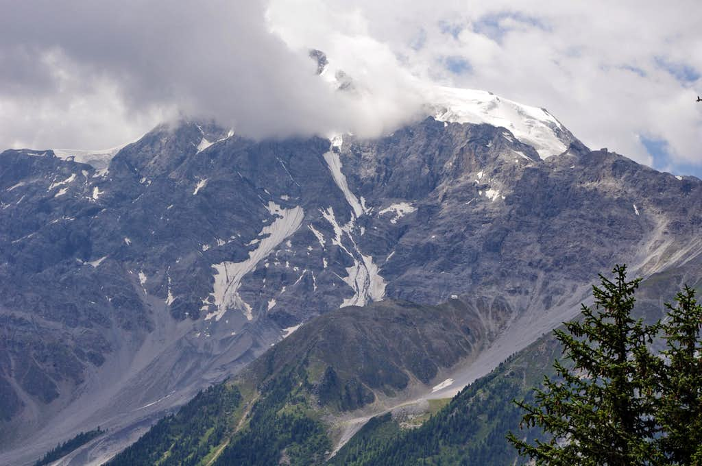 East side of a cloudy Ortles including Tabaretta and Julius Payer Huts
