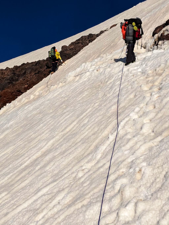 Crossing a snowbridge on ramp to Kukurtlu Dome