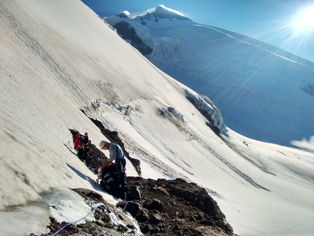 A quick break on the ramp - Elbrus West Summit in view