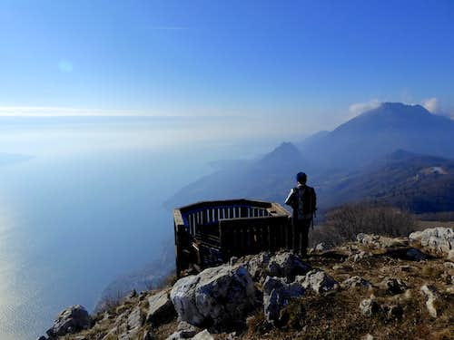 Admiring the view over Monte Pizzocolo and the lake