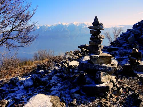 Cima Comèr summit cairn and Monte Baldo