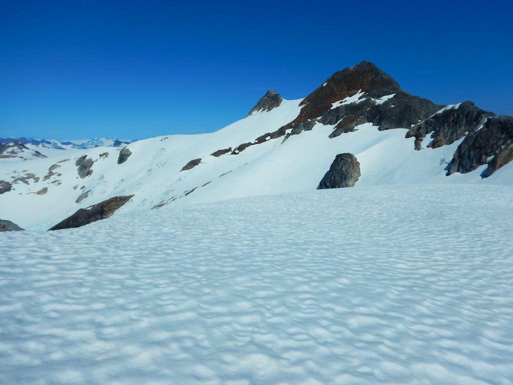 Snow crossing below summit just before cliffs