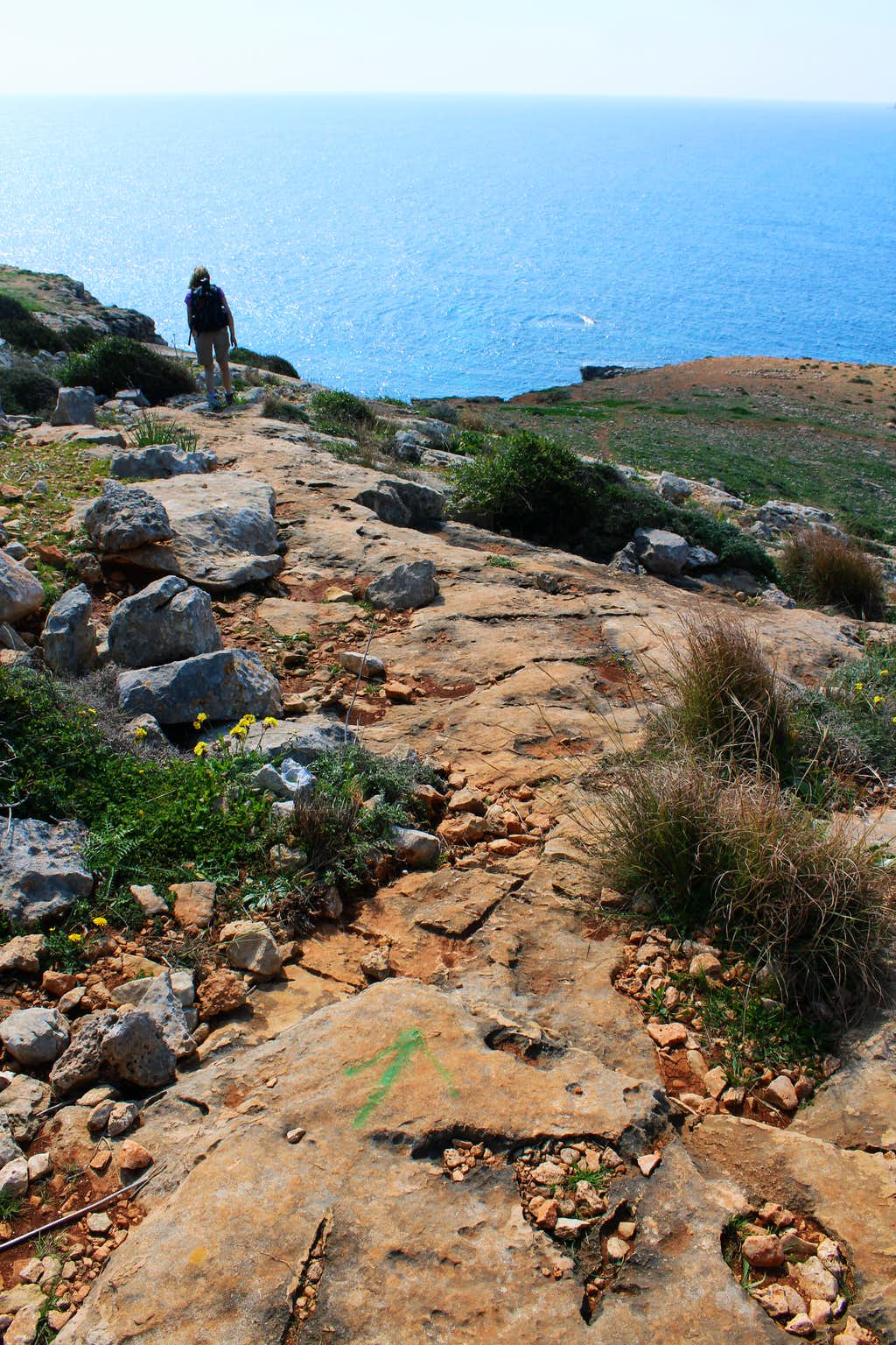 Hiking Malta's coastal paths, often the only guidance is a painted arrow!