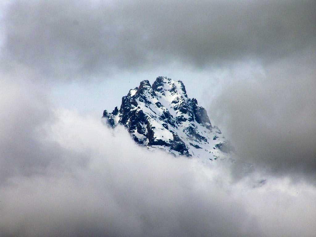 The summit of Teewinot peeks...