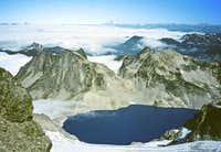 Looking down Lynch Glacier at clouds sifting onto Lynch Lake