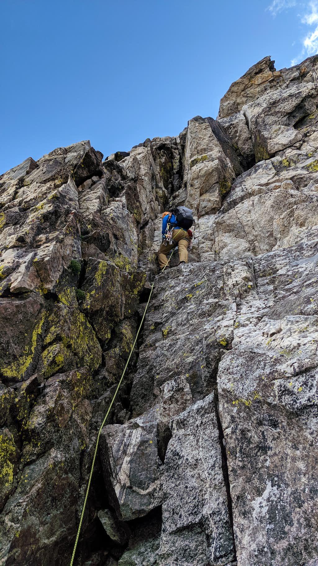 Climbing the 5.6 chimney up Ice Cream Cone