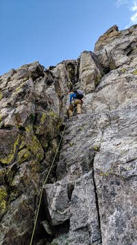 Climbing the 5.6 chimney up Ice Cream Cone