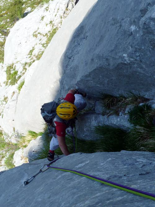 Climbing a groove on Torre Francesca, route Maestri
