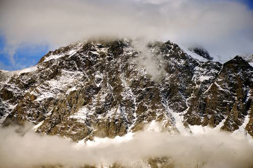 Cloudy Mont Velan with its horns, tooths & couloirs
