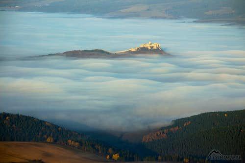 Spis castle over morning mist