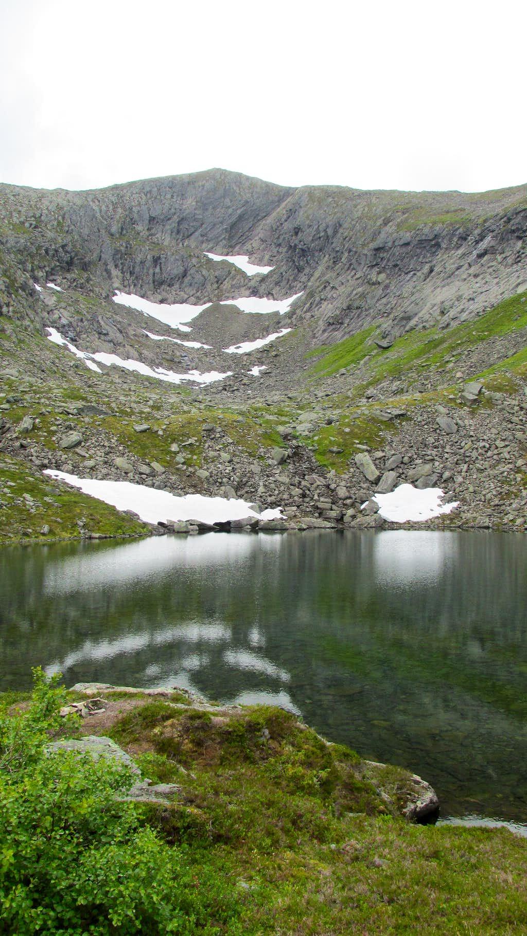 Mjolvafjellet rises behind this pituresque lake
