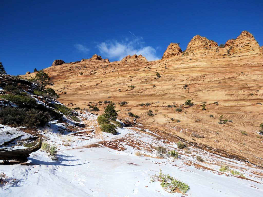 Looking back at Slickrock slopes of Point 6982 ft
