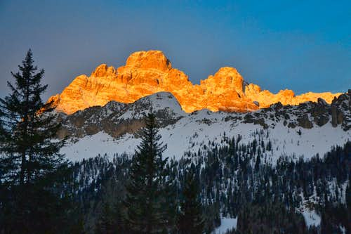 The Cristallo group in winter sunrise alpenglow
