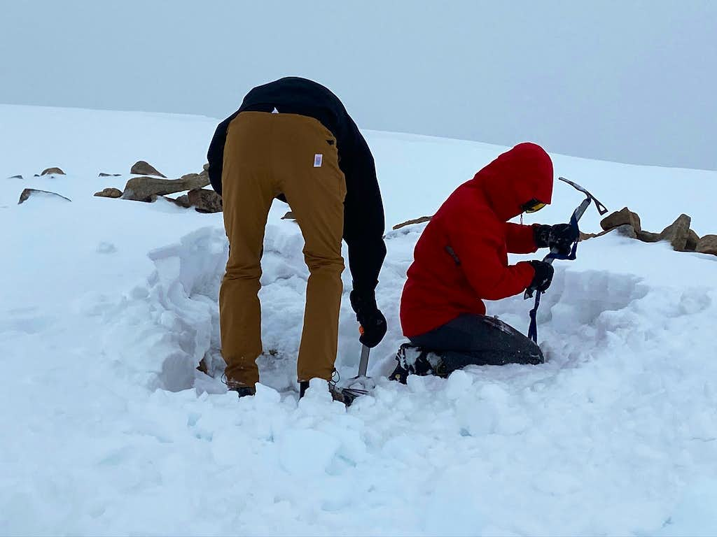 Digging out a spot for the tent at the base of Tempest