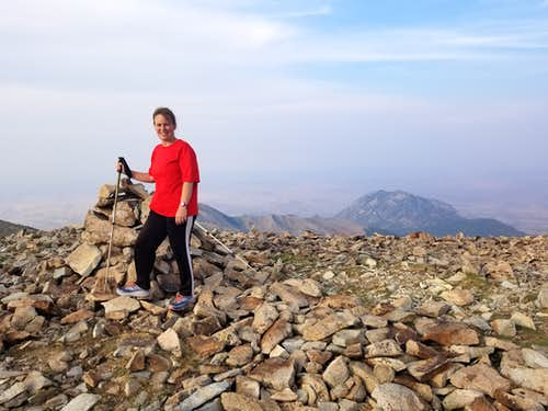 Kimberly and the summit of Mt Ellen