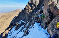 031_avoiding_difficulties_climbers_left_west_ridge_Angour