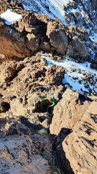 026_looking_down_first_rock_step_west_ridge_Angour