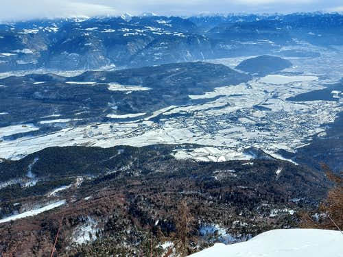 The Adige valley covered by snow seen from Monte Penegal