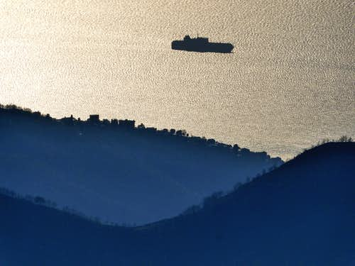 Zooming from Alpesisa on a ship in the Ligurian sea