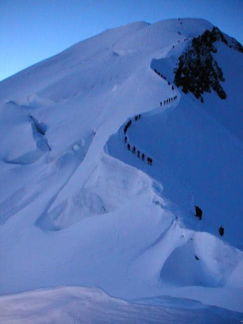 A row of climbers on the last...